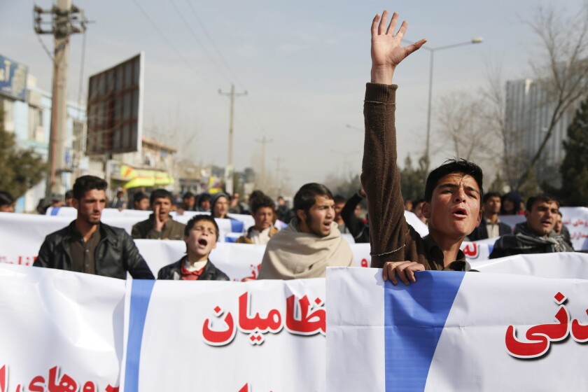 Afghans shout slogans during an anti-Taliban protest Feb. 17 in Kabul, the capital.