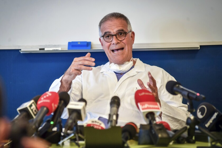 """Alberto Zangrillo, Silvio Berlusconi's longtime physician, talks to reporters at the San Raffaele hospital in Milan, Friday, Sept. 4, 2020. Former Premier Silvio Berlusconi, who tested positive for COVID-19 this week, has an early-stage lung infection but was breathing on his own Friday after being hospitalized in Milan, his personal physician said. Alberto Zangrillo, who is also on the staff of San Raffaele hospital, where Berlusconi was taken in the early hours of the day, told reporters that test results are reassuring and """"makes us optimistic"""" for his recovery over the next """"hours and days."""" (Claudio Furlan/LaPresse via AP)"""