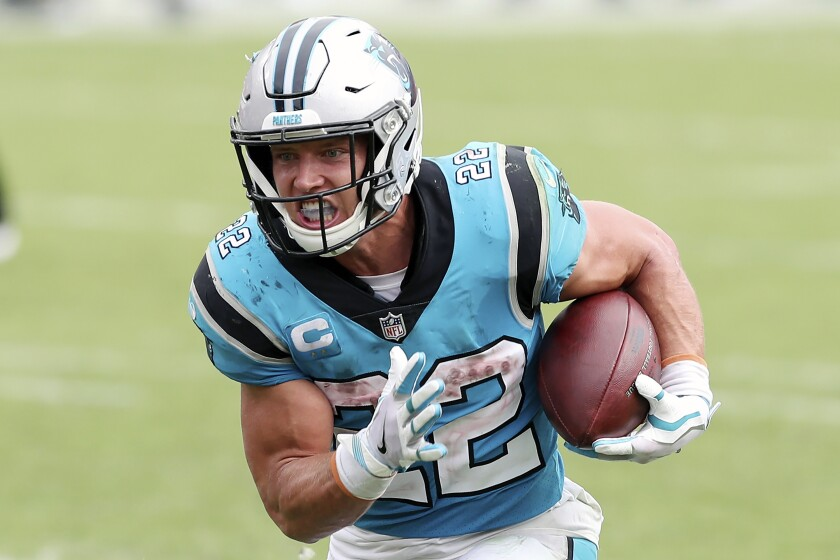 Carolina Panthers running back Christian McCaffrey (22) rushes for a touchdown against the Tampa Bay Buccaneers during the second half of an NFL football game Sunday, Sept. 20, 2020, in Tampa, Fla. The Panthers are eager to get Christian McCaffrey back on the field after he has missed four games with a high ankle sprain. (AP Photo/Mark LoMoglio)