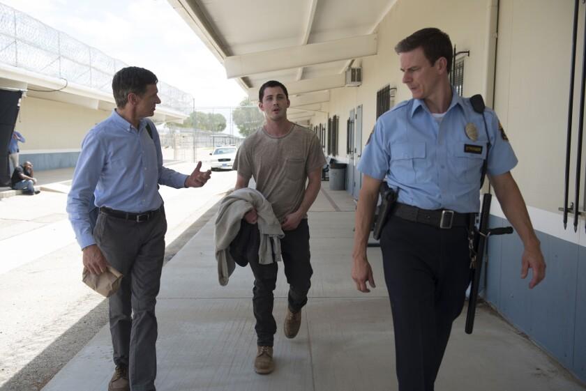 "John Hawkes, left, Logan Lerman and Shaw Jones in the movie ""End of Sentence."""