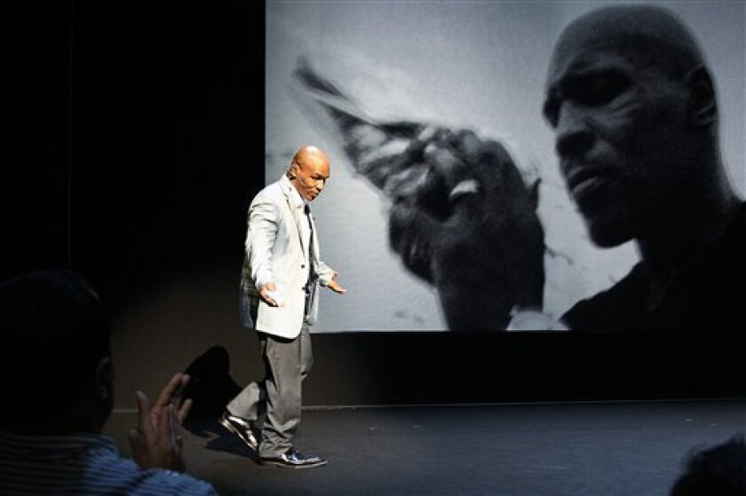 """Former boxer Mike Tyson takes part in a curtain call following his """"Mike Tyson: Undisputed Truth"""" performance on Thursday, August 2, 2012 in New York. (Photo by Donald Traill/Invision/AP)"""