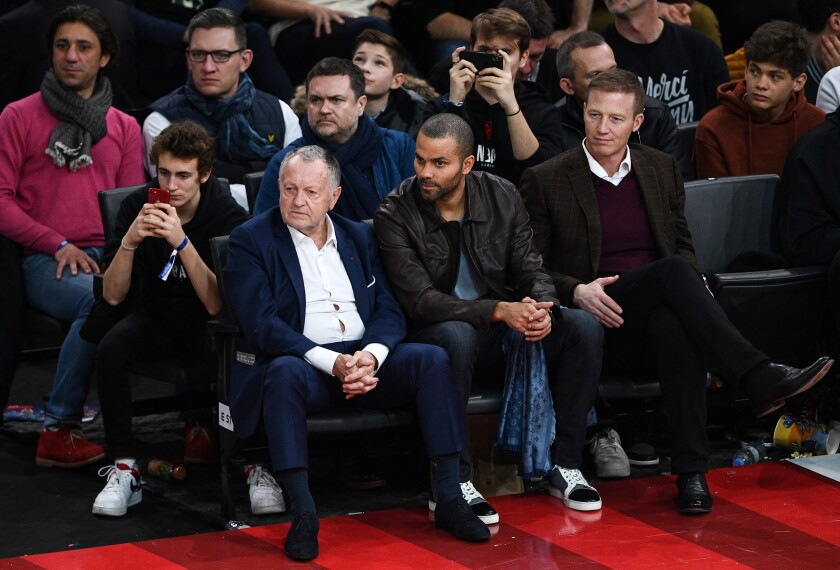 At second from right, Tony Parker, a former star with the San Antonio Spurs, follows the game Jan. 24, 2020, in Paris.