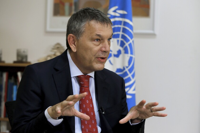 The Commissioner-General of the U.N. agency for Palestinian refugees Philippe Lazzarini, speaks during an interview with The Associated Press at the U.N. relief agency, UNRWA, headquarters in Beirut, Lebanon, Wednesday, Sept. 16, 2020. The financial crisis that the U.N. agency for Palestinian refugees is experiencing could lead to ceasing some of its activities in what would raise risks of instability in this volatile region, Lazzarini said Wednesday. (AP Photo/Bilal Hussein)