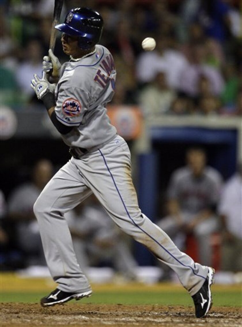 New York Mets' Ruben Tejada is hit by a ball off Florida Marlins' reliever Alex Sanabia in the seventh inning of a baseball game in San Juan, Puerto Rico, Wednesday, June 30, 2010. (AP Photo/Ricardo Arduengo)