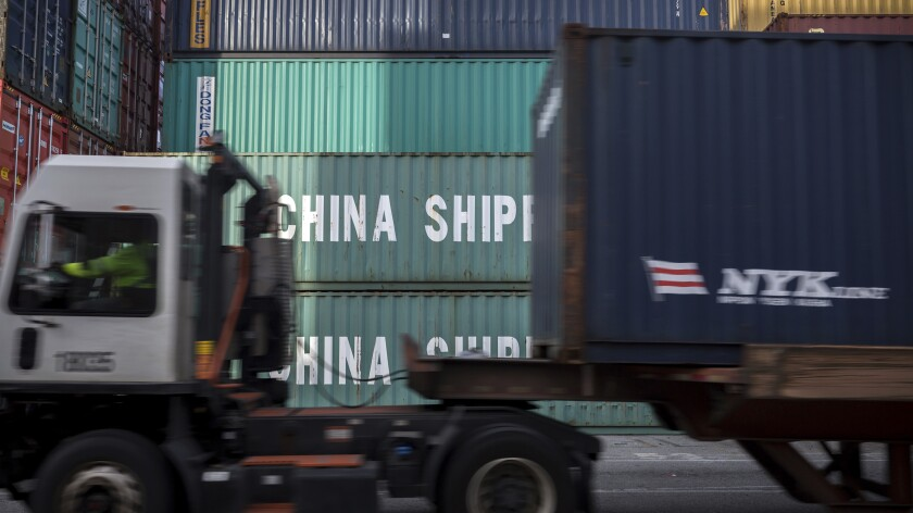 FILE - In this Thursday, July, 5, 2018 file photo, a jockey truck passes a stack of 40-foot China Shipping containers at the Port of Savannah in Savannah, Ga. Defying fears and predictions, the American job market is still shrugging off President Donald Trump's trade wars. Employers added an impressive 266,000 jobs in November, and unemployment returned to a 50-year low 3.5% _ all at a time when the Trump administration is engaged in a bruising trade war with China while fighting other U.S. trading partners as well. (AP Photo/Stephen B. Morton)
