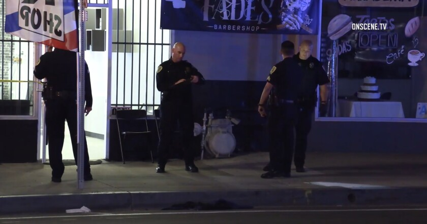 National City police investigate a shooting Wednesday night outside Kings of Fades Barbershop on Highland Avenue.