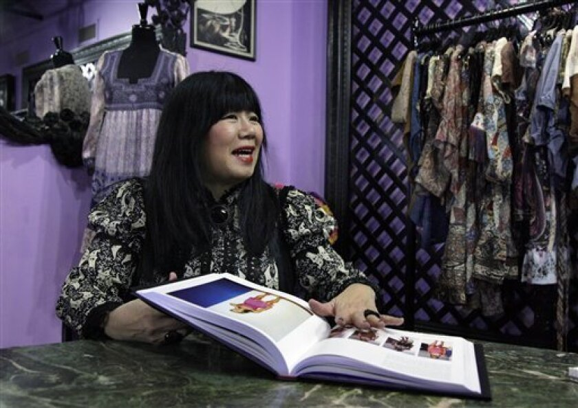 "This Monday, Nov. 29, 2010 photo shows fashion designer Anna Sui during an interview in her showroom in New York. Each runway show is a chapter in Anna Sui's life. It's a commentary on her interests, passions and mindset of the moment. Now each runway show is also a chapter in the new book, ""Anna Sui,"" which, she says, is an autobiography in pictures. (AP Photo/Richard Drew)"