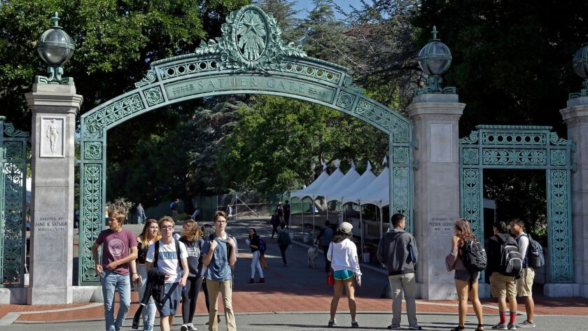 Students walk past Sather Gate on the University of California, Berkeley campus in Berkeley, Calif. on April 21.