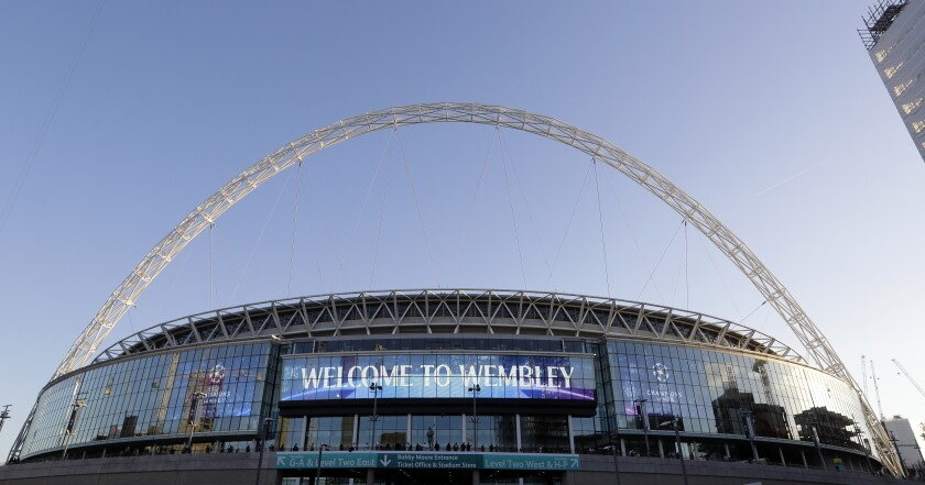 """FILE - This Oct. 3, 2018 file photo shows a view of the exterior of Wembley Stadium in London. The Jacksonville Jaguars will play two home games in London next season, strengthening the franchise's foothold in an overseas market the NFL is eager to expand. The Jaguars will play back-to-back games at historic Wembley Stadium, giving them a potential """"home-field"""" advantage in the second one since they won't have to travel that week. Specific dates were not announced.(AP Photo/Kirsty Wigglesworth, File)"""