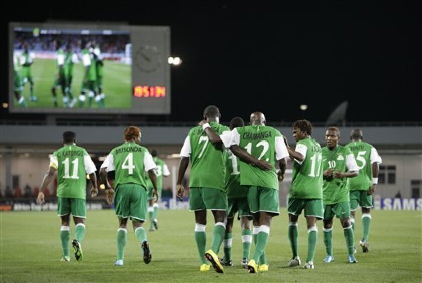 Zambia celebrates after a goal by  Jacob Mulenga, third from left, during their African Cup of Nations Group D soccer match at Tundavala Stadium in Lubango, Angola Wednesday, Jan. 13, 2010. (AP Photo/Rebecca Blackwell)