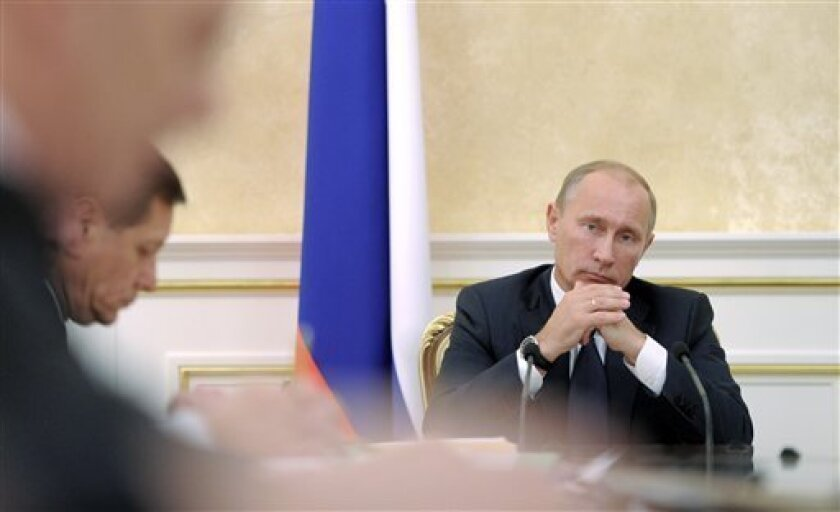Russian Prime Minister Vladimir Putin chairs a Cabinet meeting in Moscow, Tuesday, Sept. 27, 2011. (AP Photo/RIA Novosti, Alexei Druzhinin, Pool)