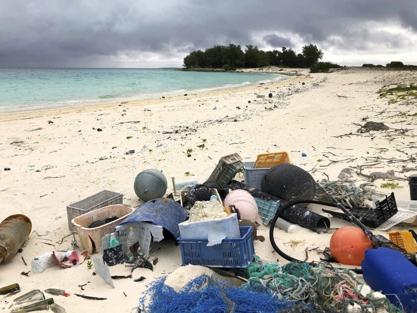 Trash carried by ocean currents is piled on a beach on Midway Atoll in the northwestern Hawaiian Islands in 2019.