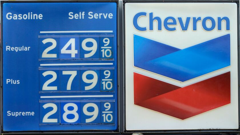 This photo taken Wednesday, May 3, 2017, shows the gas prices at a Chevron station in Miami. On Frid