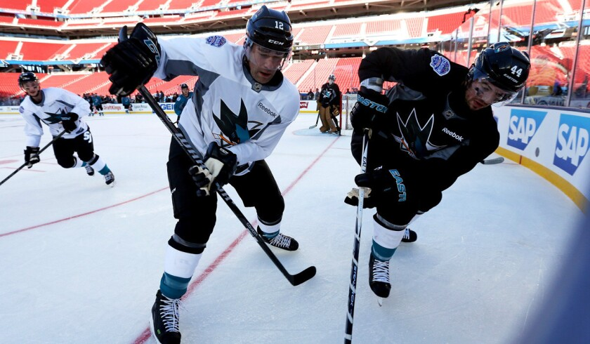San Jose Sharks players Patrick Marleau, left, and Marc-Edouard Vlasic practice at Levi's Stadium for the 2015 Coors Light NHL Stadium Series game against the Kings.