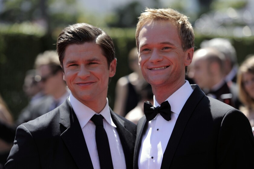 David Burtka, left, and Neil Patrick Harris married in Italy over the weekend. Above, the couple at the Creative Arts Emmy Awards in 2010.
