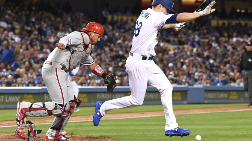 LOS ANGELES, CALIFORNIA MAY 30, 2018-Dodgers pitcher Ross Stripling lays down a sacrafice bunt to lo