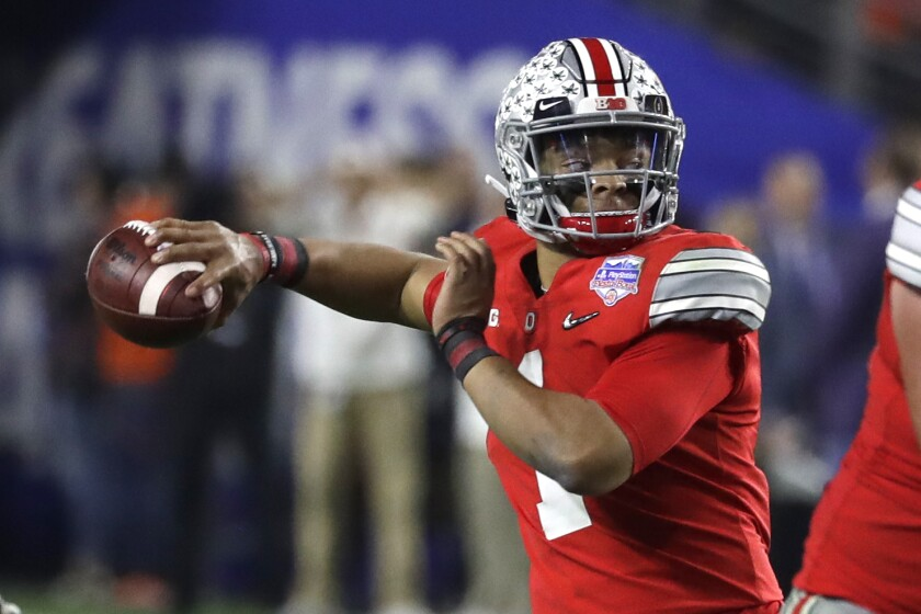 Ohio State quarterback Justin Fields looks to pass during the first half of the Fiesta Bowl against Clemson on Dec. 28