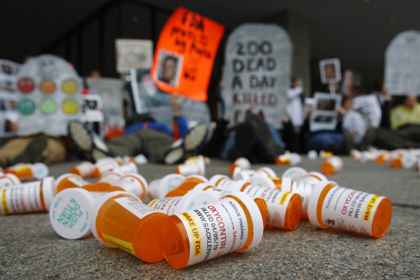 Containers depict OxyContin prescription pill bottles
