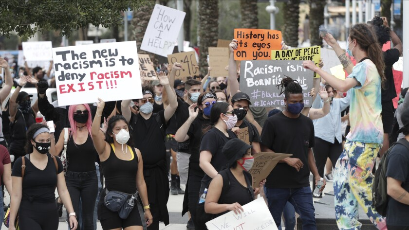 Demonstrators march June 2 in Orlando, Fla., during a protest over the death of George Floyd.