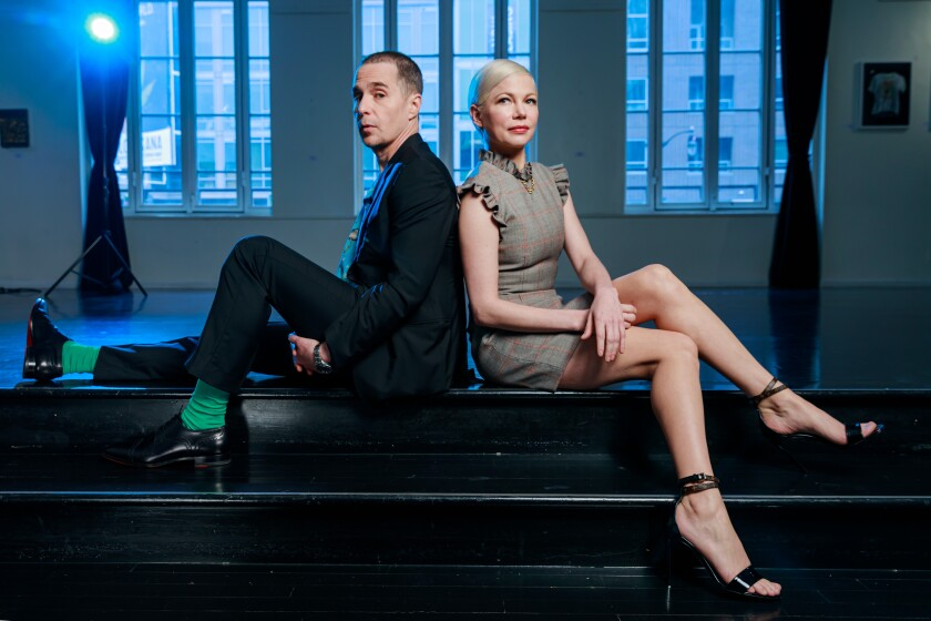 "Sam Rockwell and Michelle Williams of FX's ""Fosse/Verdon"" pose back to back on the edge of a stage in Los Angeles"