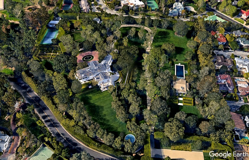 Amazon founder Jeff Bezos set a new California record with the $165-milllion purchase of David Geffen's Beverly Hills estate. The Georgian Revival-style mansion was built in the 1920s for movie mogul Jack Warner.