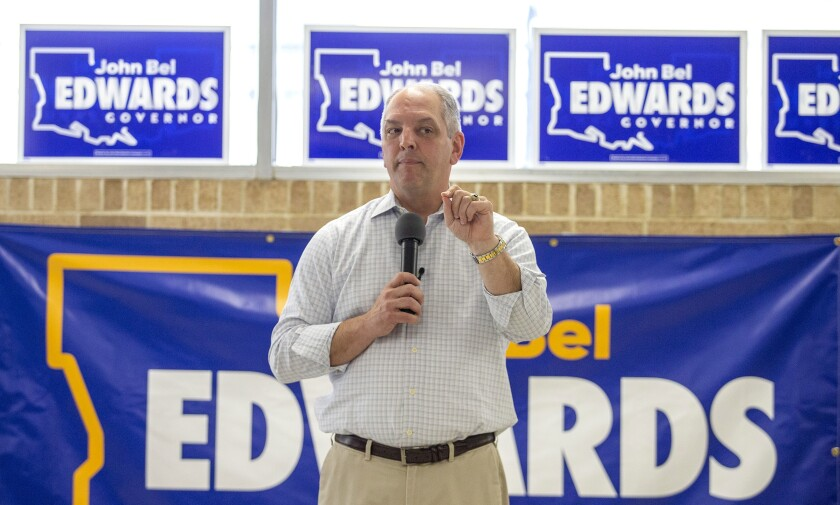 FILE - In this July 8, 2019 file photo, Louisiana Gov. John Bel Edwards stumps for re-election during a campaign stop in New Orleans, La. While Democrats in Washington charge ahead with an impeachment inquiry, their party's candidates for governor in three Southern states are doing their best to steer the conversation away from Republican President Donald Trump and toward safer ground back home. Edwards, who leads in the polls, faces two major Republican opponents in the Oct. 12 primary. (David Grunfeld/The Advocate via AP, File)