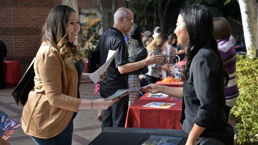 Natasha Marano, left, counselor at Cerritos College, talks with Susan Park, director of admissions f