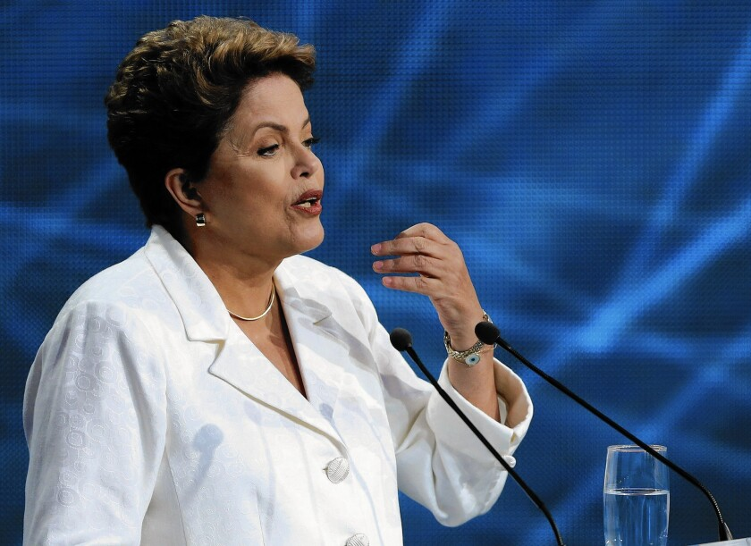 Brazilian President Dilma Rousseff touted her Workers' Party's flagship Bolsa Familia social program, which aids the poor.
