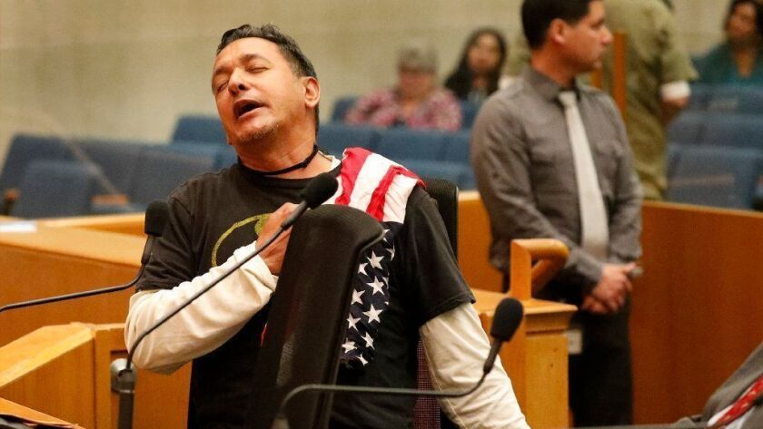 """Armando Herman, who goes by """"Herman Herman,"""" at the Los Angeles County Board of Supervisors meeting April 9."""