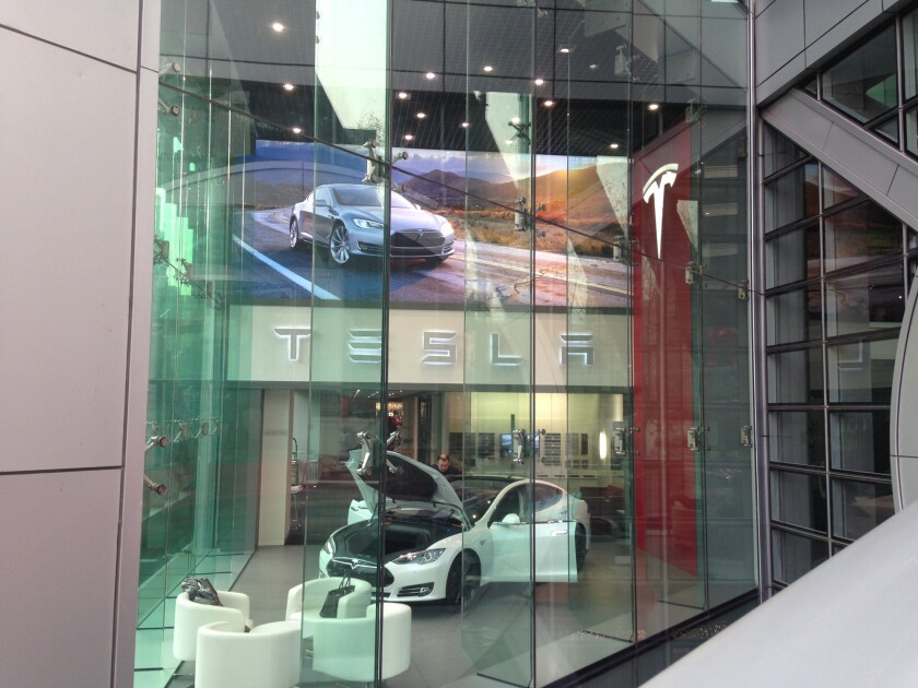 "Are the Teslas being shipped to China not winding up in consumer's hands? An analyst believes they're being ordered at showrooms, like this one in a Beijing shopping center, but are actually being bought by speculators or ""scalpers."""