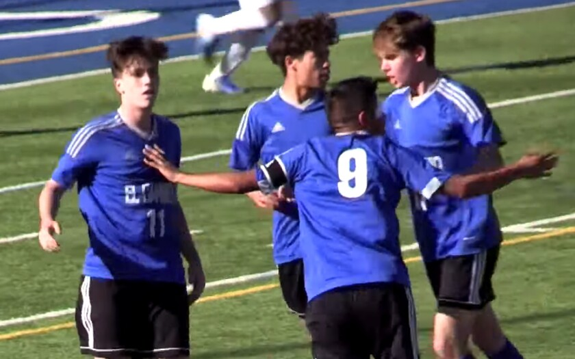 El Camino Real teammates celebrate after Luca Thomaseto (11) scored on a penalty kick against Birmingham on Feb. 25, 2020.