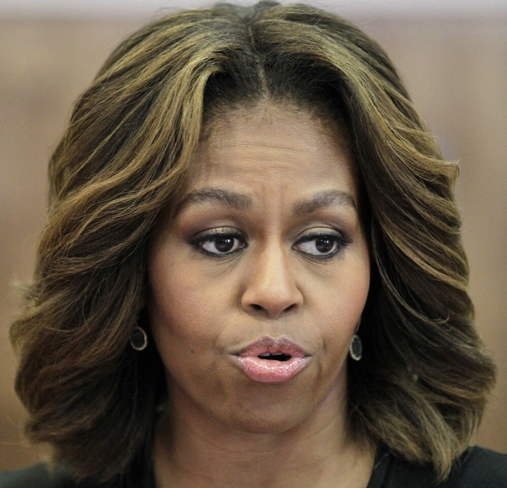 First Lady Michelle Obama unveiled her new look during official duties this week.