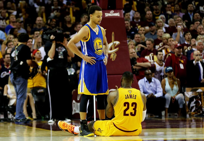 Golden State's Stephen Curry stands over Cleveland's LeBron James during Game 3 of the NBA Finals on June 9.