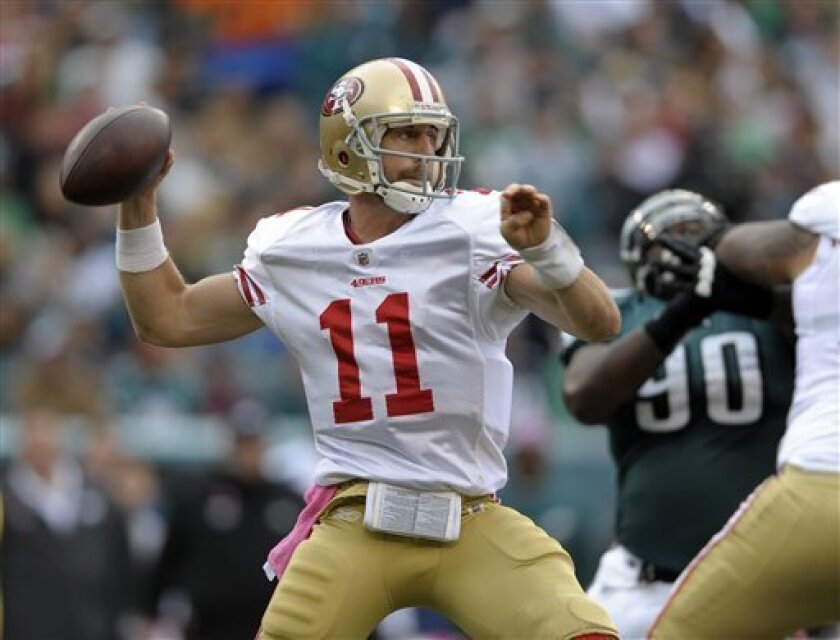San Francisco 49ers quarterback Alex Smith (11) looks to pass in the first half of an NFL football game against the Philadelphia Eagles on Sunday, Oct. 2, 2011, in Philadelphia. (AP Photo/Michael Perez)