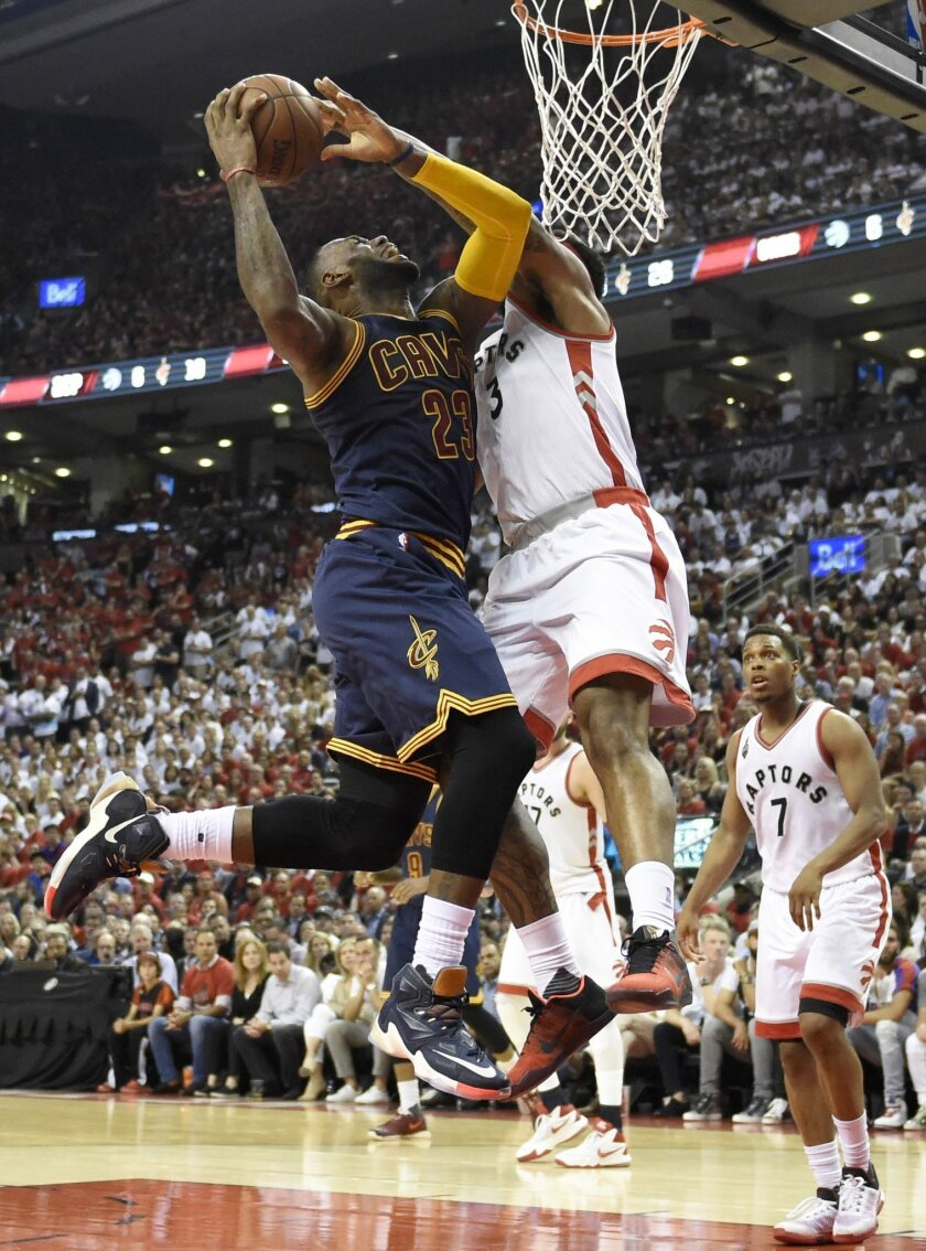 Cleveland Cavaliers forward LeBron James drives to the basket against Toronto Raptors forward James Johnson during the second half of Game 6 of the NBA basketball Eastern Conference finals, Friday, May 27, 2016, in Toronto. (Frank Gunn/The Canadian Press via AP)