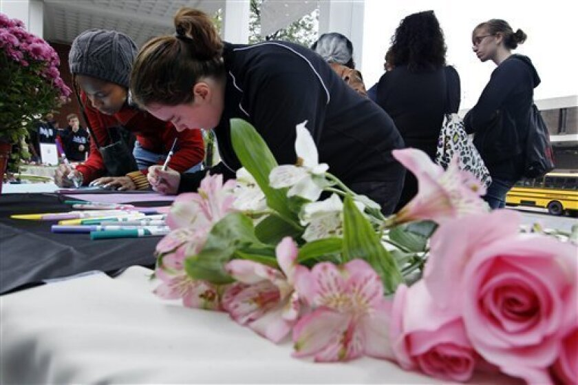 FILE - In this Oct. 1, 2010 file photo, Rutgers University students sign condolence cards at Rutgers in New Brunswick, N.J., for the family of fellow student Tyler Clementi. Rutgers University has planned a silent vigil to remember Clementi, who committed suicide after his sexual encounter was secretly streamed online (AP Photo/Mel Evans, File)