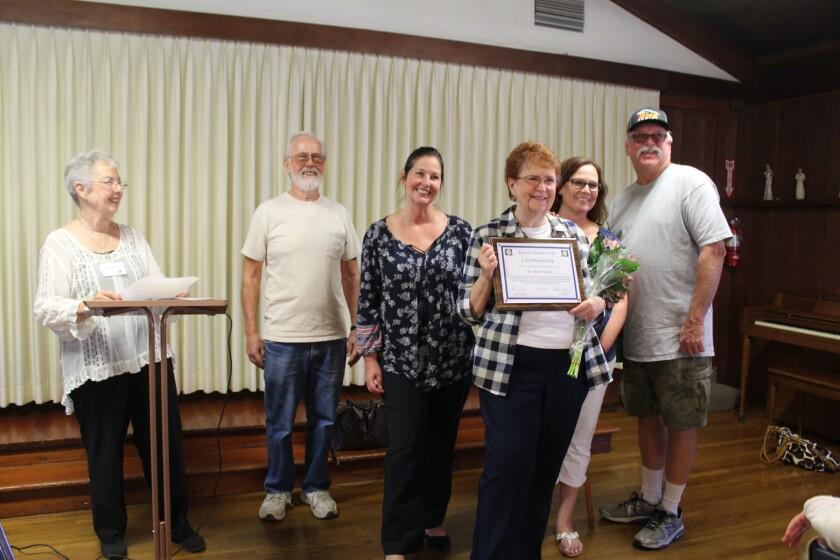 Karen Stangl receives a Lifetime Achievment Award from the Ramona Woman's Club.