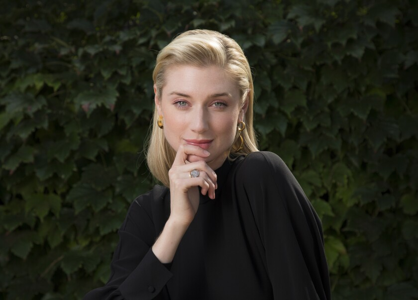 """FILE - Actress Elizabeth Debicki appears during a portrait session at the 76th edition of the Venice Film Festival, in Venice, Italy, on Sept. 7, 2019. Debicki stars in the Christopher Nolan film """"Tenet."""" (Photo by Joel C Ryan/Invision/AP, File)"""