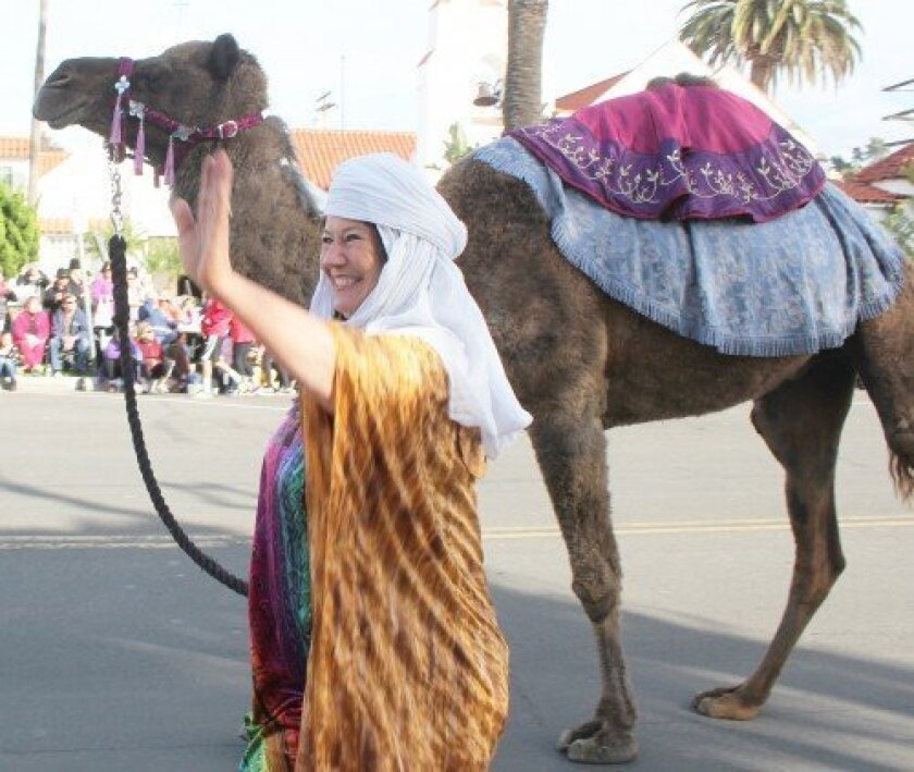 A scene from 2013's La Jolla Christmas Parade and Holiday Festival. According to the Bible, three kings riding camels came to Bethlehem to witness the birth of Jesus Christ, who is believed by Christians to be the son of God. File