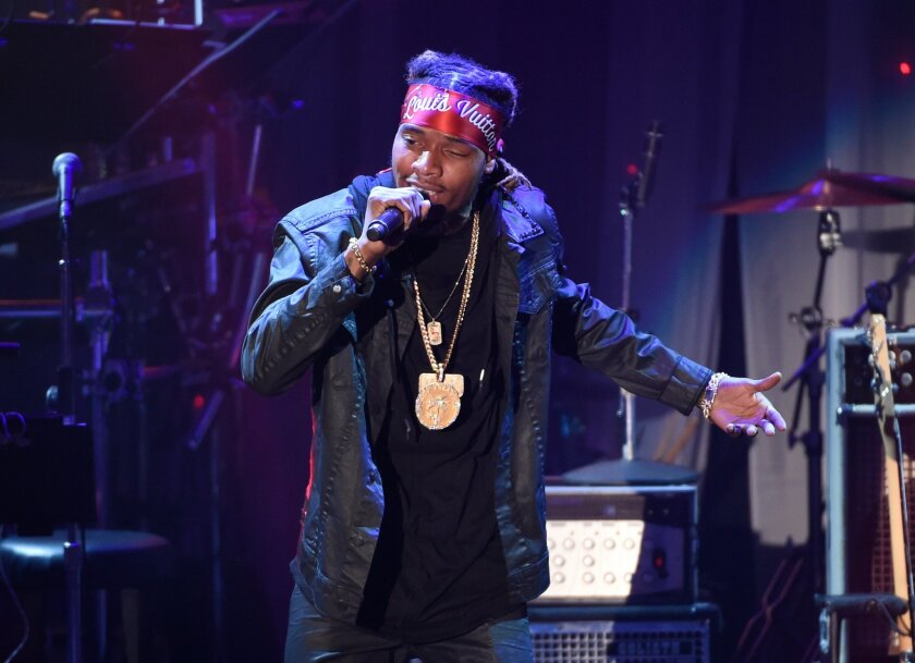FILE - In this Feb. 14, 2016 file photo, Fetty Wap performs at the 2016 Clive Davis Pre-Grammy Gala in Beverly Hills, Calif. A New Jersey school district is investigating how rapper Fetty Wap was allowed to record a music video that included drug references and a pole dancer in his old high school.