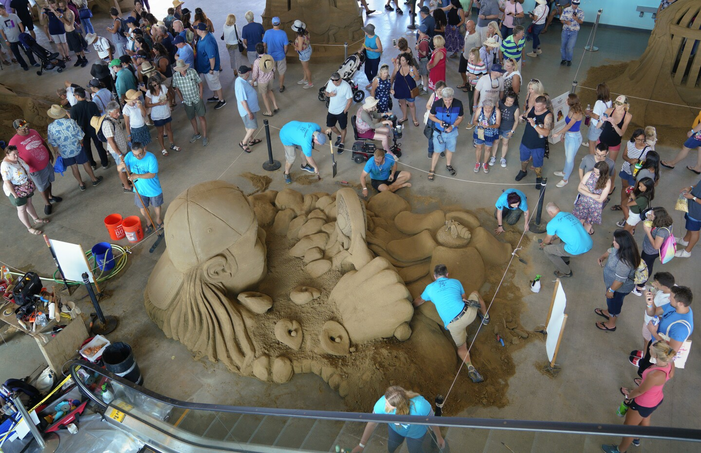 Team Sand Squirrel worked on their sand sculpture in the I.B. Challenge Class during the U.S. Sand Sculpting Challenge held in downtown San Diego on Sunday, September 1, 2019.