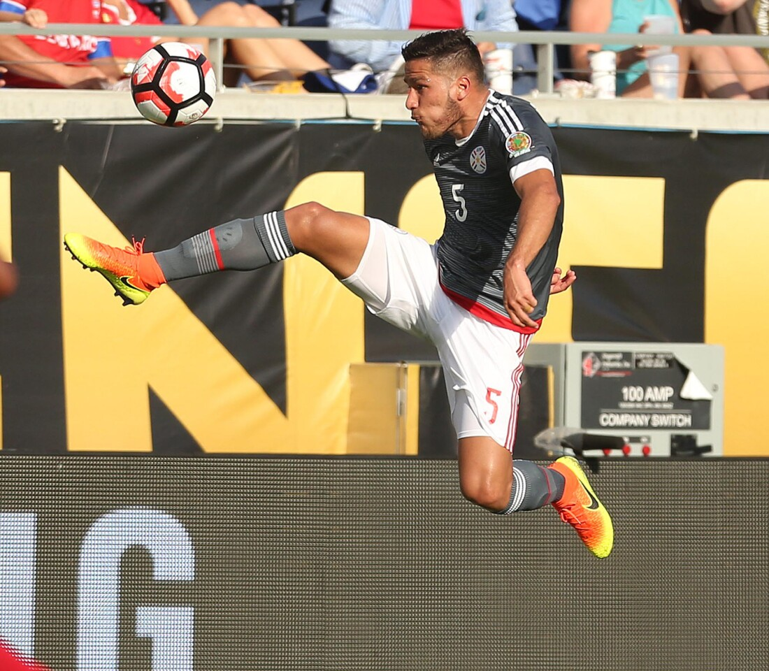 Paraguay's Bruno Valdez makes an athletic play against Costa Rica during the start of pool play in the Copa America at Camping World Stadium in Orlando, Fla., on Saturday, June 4, 2016. The teams tied, 0-0.