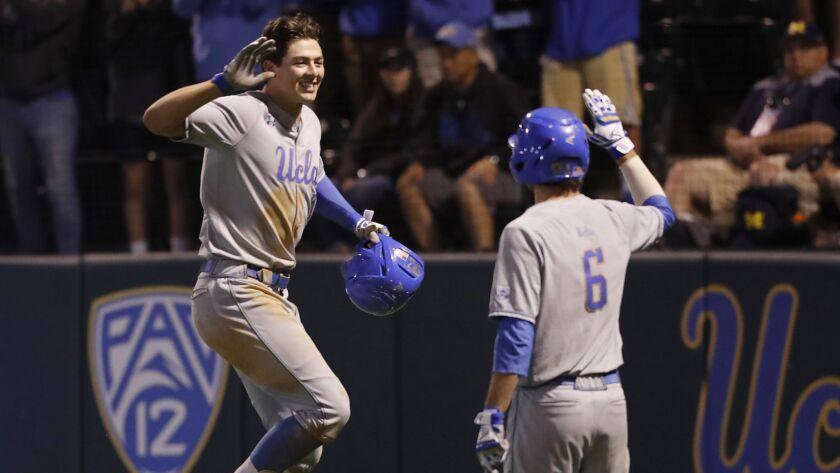 LOS ANGELES, CALIF. - JUNE 8, 2019. UCLA first baeman Michael Toglia is congratulated by teammate