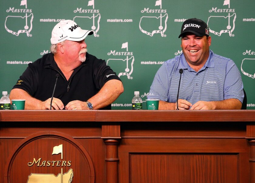 Masters champion Craig Stadler, left, and his son, Kevin Stadler, who is playing in his first Masters, share a laugh while holding a joint father-son press conference at Augusta National Golf Club in Augusta, Ga., Monday, April 7, 2014. (AP Photo/Atlanta Journal-Constitution, Curtis Compton) MARIETTA DAILY OUT; GWINNETT DAILY POST OUT; LOCAL TV OUT; WXIA-TV OUT; WGCL-TV OUT
