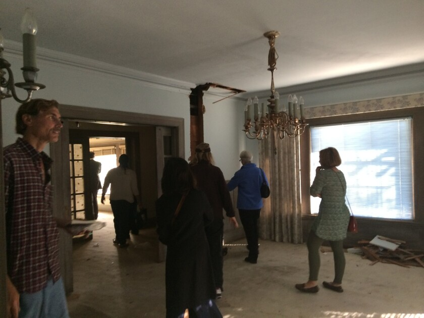 Neighbors and other members of the public walk through the Bartlett House on Kenmore Avenue in Los Feliz.