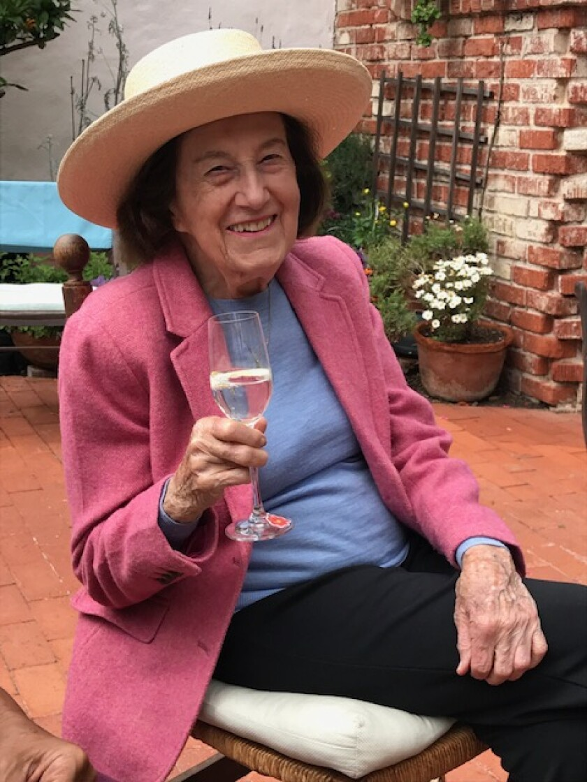 Lucienne Guillemin, who turns 100 on Feb. 18, enjoys wine daily with her husband at their home in La Jolla.