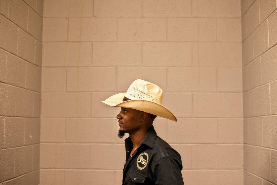 A cowboy stands in the corner of the locker room at the MGM Grand Arena
