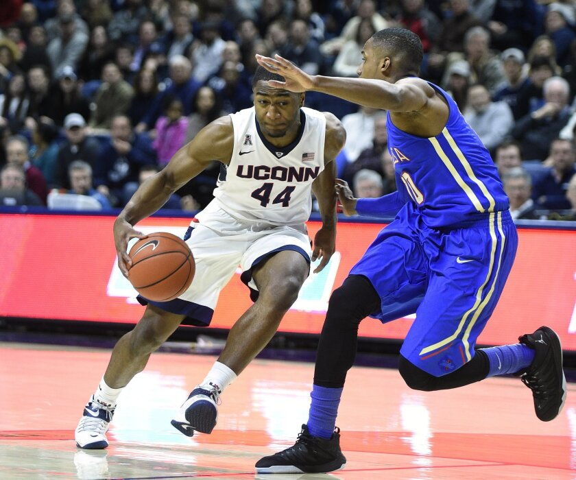 Connecticut's Rodney Purvis (44) drives past Tulsa's James Woodard (10) during the first half of an NCAA college basketball game in Storrs, Conn., on Saturday, Feb. 13, 2016. (AP Photo/Fred Beckham)