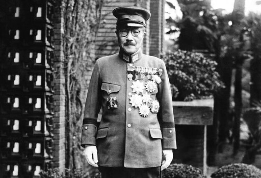 In this undated photo, former Japan's Prime Minister General Hideki Tojo is shown with medals outside of the Diet. The declassified U.S. military documents show the ashes of seven executed war criminals, including wartime Prime Minister Tojo, were scattered at sea off Yokohama from a U.S. army plane. (AP Photo/Charles Gorry)