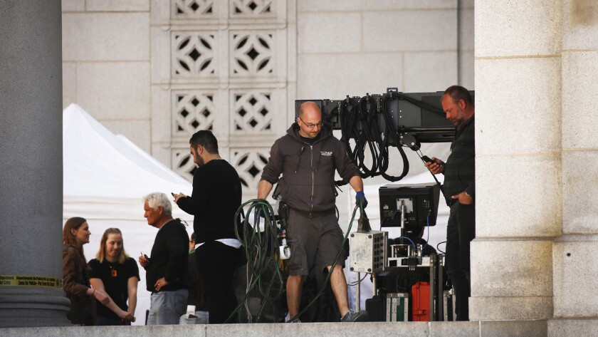 """A film crew works on the film """"Ocean's Eight"""" as it shoots outside Los Angeles City Hall."""